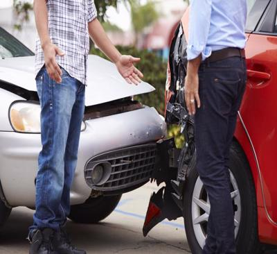 This image shows two men arguing after a car accident.