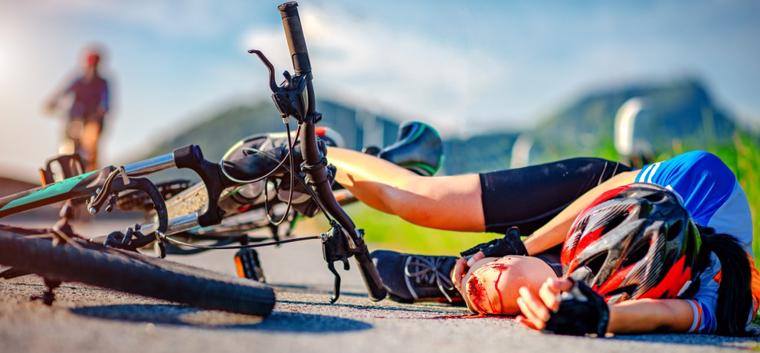 This image shows a bike rider seriously injured after an Atlanta bike accident.