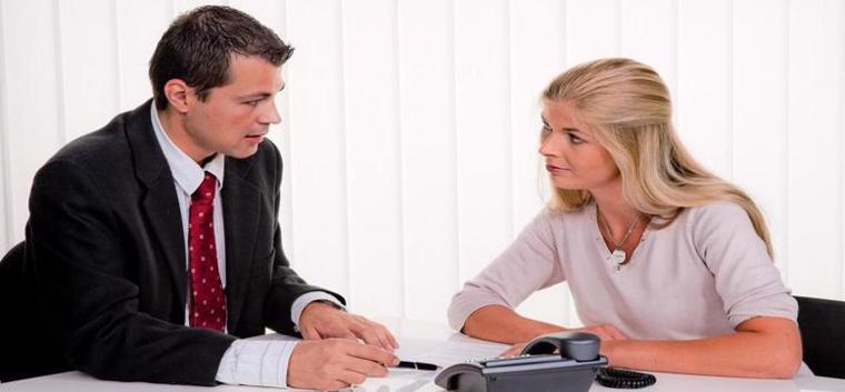 Wrongful death attorney speaking with a client