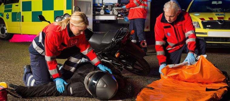 Paramedics helping a motorcycle crash victim in Atlanta