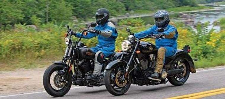 Two men riding motorcycles side by side in Atlanta, GA