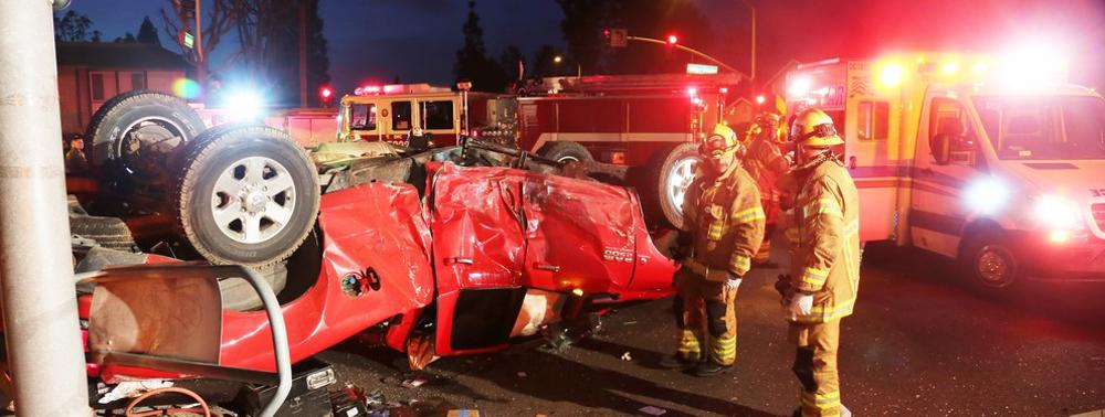 This image shows rescue personnel responding to a car accident.
