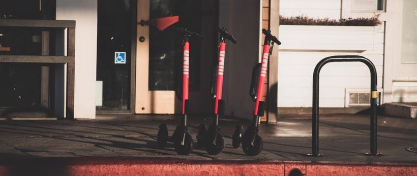 Three Uber Jump scooters are shown on a street curb. An Atlanta Uber Jump scooter accident lawyer isnt afraid to take on Uber.