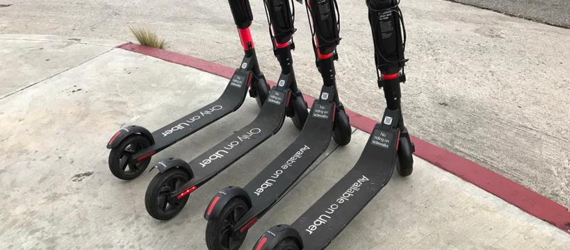 Four Uber Jump scooters are shown together on a street in Atlanta.