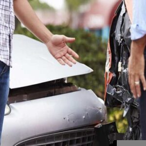 Two men argue over fault after a car accident.