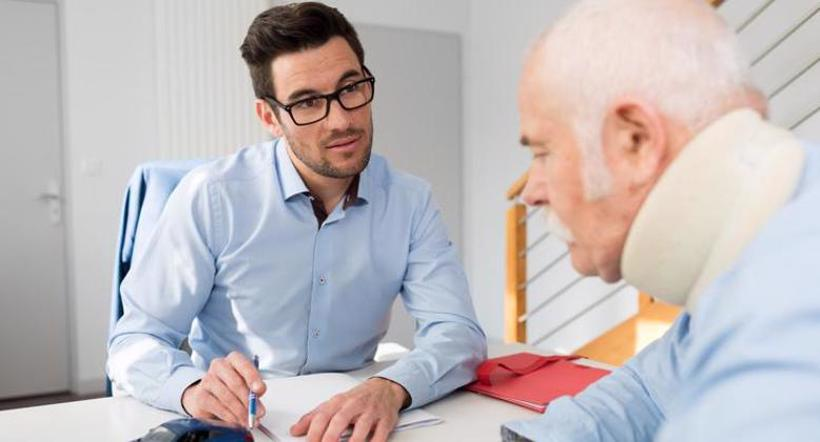A Fayetteville personal injury lawyer speaks with a client