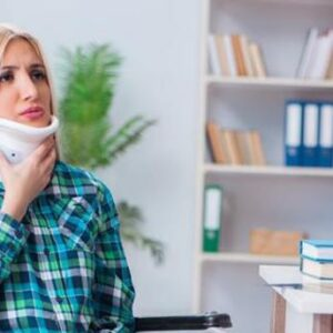 A Dublin personal injury lawyer speaks with a woman wearing a neck brace.