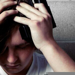 Teen looking distraught after friendly fire results in teen death