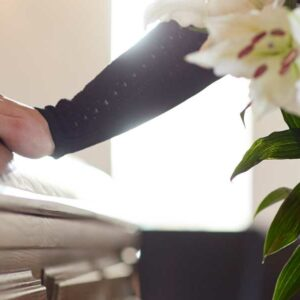 Widow at funeral. Wrongful death damages.