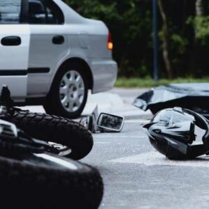 Motorcycle hit by car, concept of motorcycle crashes